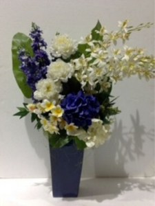 Large blue vase arrangement