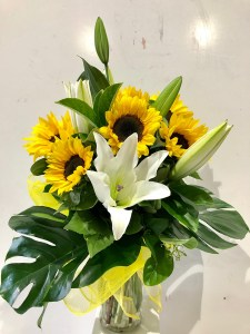 Sunflowers and Lilies in a Vase